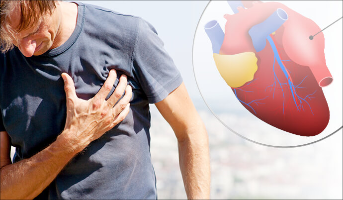 man holding chest with heart pain