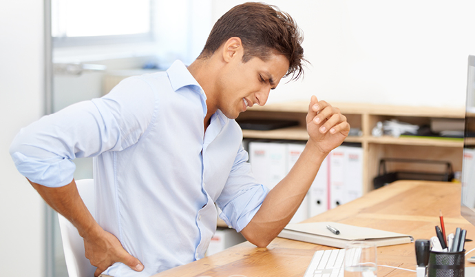 man sitting with back pain