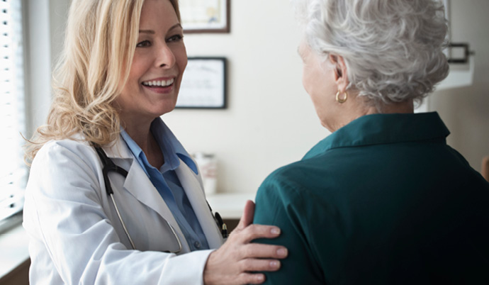 doctor interacting with an older woman
