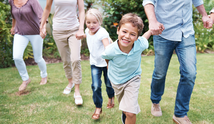 little boy holding hand with family running