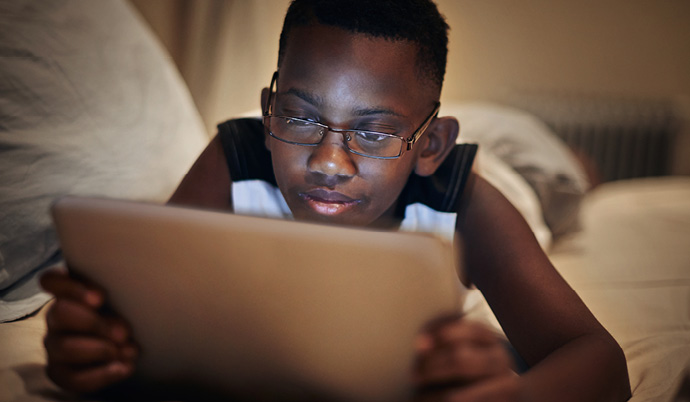 boy looking at a tablet