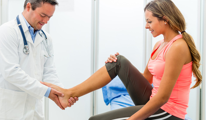 doctor examining a young girls ankle