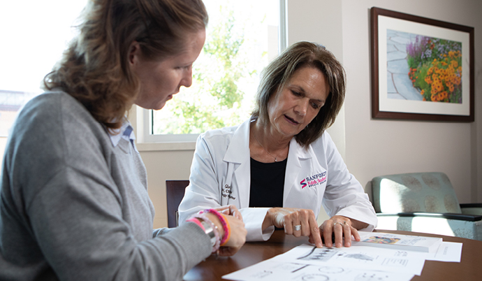 doctor explaining document to a patient