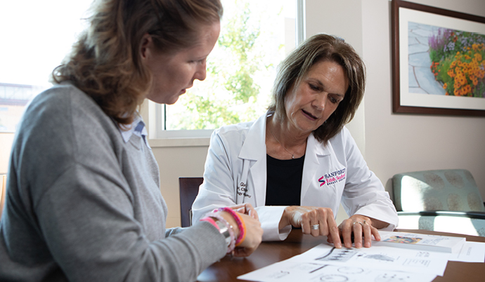 physician explaining documents to a patient